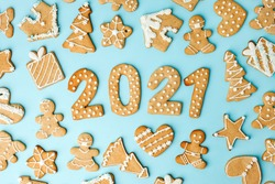 Winter Holiday pattern - set of gingerbread on light blue background - man in mask, house, xmas tree, stars and Number Happy New Year 2021, Merry Christmas background, trendy concept