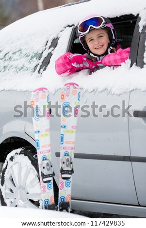 Winter holiday, ski - happy child on the road for ski holidays