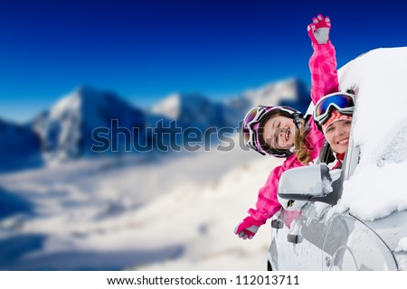 Winter holiday, ski, travel - happy family on the road for winter holidays