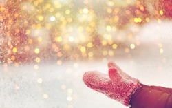 winter holidays, christmas and people concept - close up of woman throwing snow outdoors