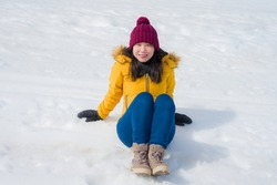 Winter holidays in the snow - lifestyle portrait of young happy and beautiful Asian Chinese girl enjoying playful at frozen lake in snowy mountains at Swiss Alps