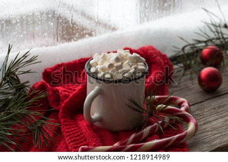 Winter hot Christmas chocolate or cocoa with marshmallow with decorations.