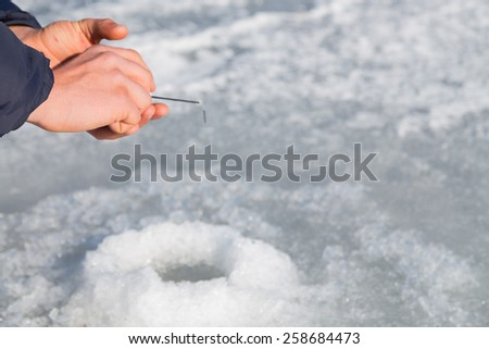 Winter ice fishing. Fishing rod for ice fishing. Hobbies, winter fishing.