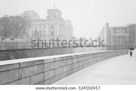 Winter in Berlin City with walking People and The Reichstag building (Bundestag) - famous landmark in Berlin, Germany, Europe - stock photo