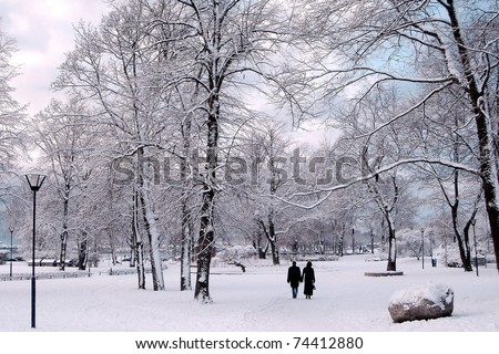 Winter in City Park. Couple in winter park.