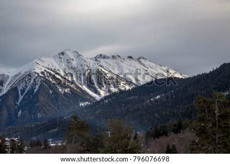 Winter in mountains, a beautiful view of snow slopes and tops, the picturesque gorge. Wild nature of the North Caucasus #796076698