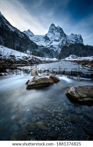 winter in Rosenlaui with Wellhorn and mountain creek Rychenbach, Switzerland