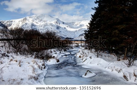 Winter in Snowdonia with snow on the Mountains Snowdon national park North Wales #135152696
