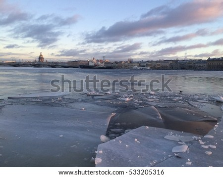 Winter in the city. The ice floes on the Neva river in Saint-Petersburg. #533205316