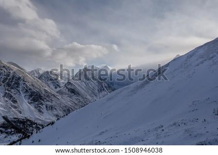 Winter in the mountains in Altai, Altai mountains, rest in the mountains in winter, Lake Akkem, Belukha Mountain