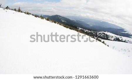 Winter in the mountains. Snowy slopes. Ski slopes Svidovets spine. Dragobrat Ukraine #1291663600