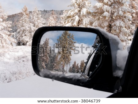 Winter in the rear-view mirror of auto.