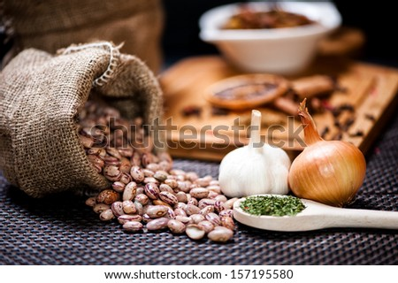 winter ingredients such as bean seeds, onions and garlic or dried hot spicy pepper - stock photo