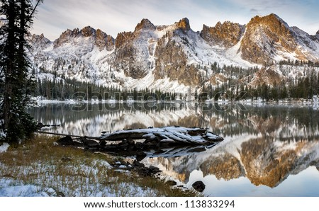 Winter lake scene with snow and mountains