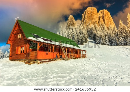 Winter landscape and wooden hut in the mountains,Lonely Rock,Transylvania,Carpathians,Romania,Europe