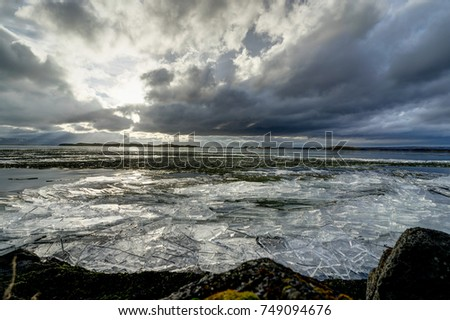 Winter Landscape frozen lake with ice floes and cloudy sky in Ic #749094676