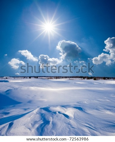 winter landscape in a snow under a sparkle sun - stock photo