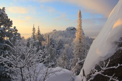 Winter landscape in Siberia. Stolby Nature Reserve. Krasnoyarsk region. Russia Stolby Nature Reserve, in English, `The Pillars` is a Russian strict nature reserve located 10 km south of the city of Kr