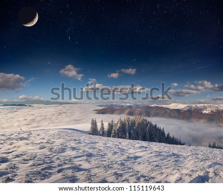 Winter landscape in the mountains with stars and moon in the sky