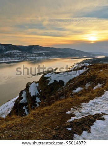 Winter landscape. Mountains and river.