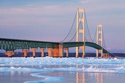 Winter landscape near sunset of the Mackinac Bridge and the frozen Straits of Mackinac, Michigan's Upper and Lower Peninsulas, USA
