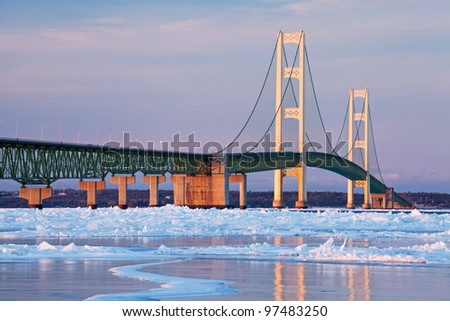 Winter landscape near sunset of the Mackinac Bridge and the frozen Straits of Mackinac, Michigan's Upper and Lower Peninsulas, USA
