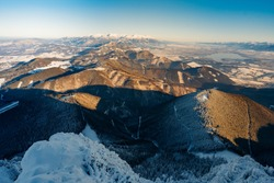 Winter landscape of mountain panorama from peak Velky Choc, Slovakia. View of the valley and white mountains with frozen mountain pine in the foreground. Little Fatra