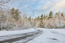 Winter landscape of New England on a sunny day after the first snow, Boston, Massachusetts, USA.