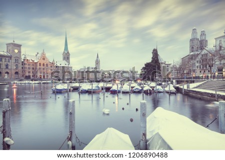 Winter landscape of Zurich with lake with boats on foreground, Switzerland #1206890488