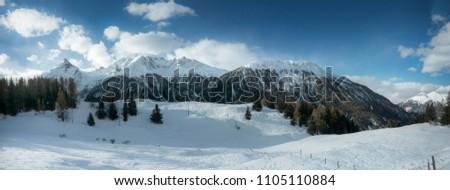 Winter landscape panorama mountain range in Switzerland sunny day. High resolution, 34 megapixels. #1105110884