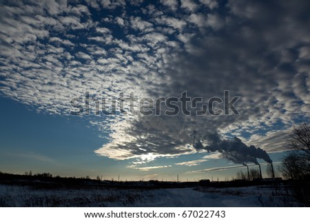 winter landscape, sky with clouds, the smoke from the chimneys of thermal power plants