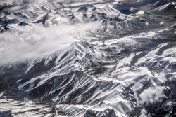 Winter landscape snow mountain high angle view from airplane Leh Ladakh India.