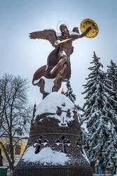 Winter landscape view of the bronze sculpture of the Archangel Michael in Kiev on Vladimirskaya mountain
