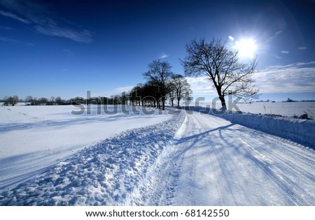 Winter landscape. White snow and crystal blue sky