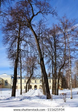 Winter landscape with an old Russian manor among the snow-covered trees
