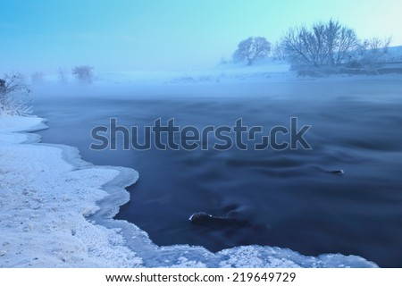 Winter landscape with cold winter river sunrise.