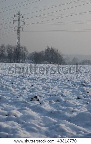Winter landscape with electric powerline