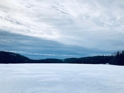 Winter landscape with frozened lake in Quebec, Canada. Snow and ice