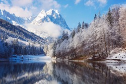Winter landscape with lake and reflection