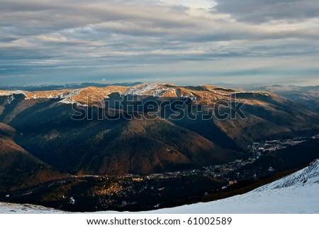 Winter landscape with Sinaia city, a mountain city at the base of Bucegi mountains, in Prahova valey - Romania.