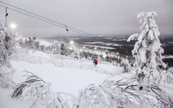 Winter landscape with ski lift in Levi resort in Lapland, Finland, at polar night