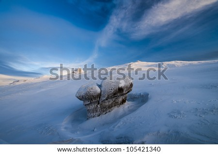 Winter landscape with snow and rock in the morning light