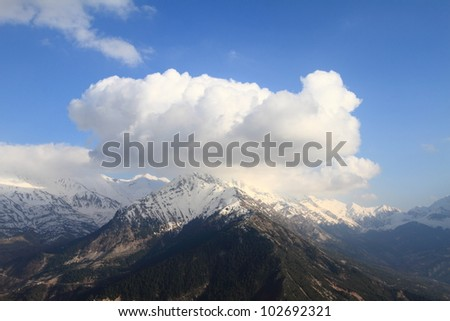 Winter landscape with snow-covered mountains