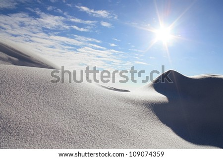 Winter landscape with the blue sky and the sun