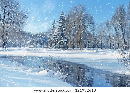 Winter landscape with the river in frosty day - Shutterstock ID 121992610