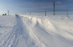Winter lane and field, drifted snow, winter beautiful landscape