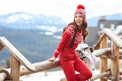 winter, leisure, sport and people concept - happy young woman in ski clothes outdoors