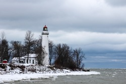 Winter light. Point Aux Barques Lighthouse on a remote winter shore. Lighthouse County Park. Port Hope, Michigan.