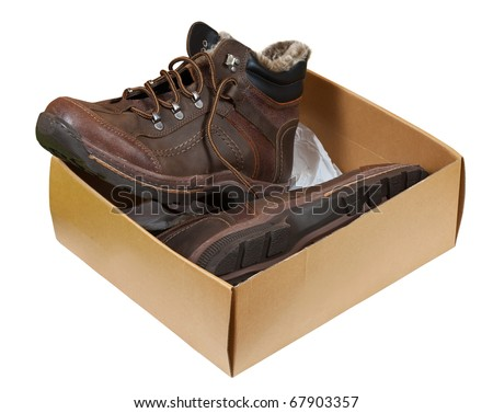 Winter men boots in sale box. Isolated on  white background - stock photo