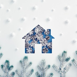 Winter minimal concept - House silhouette made of snowy pine cone with abstract snow forest pattern. Square composition, flat lay, top view. Winter holiday layout